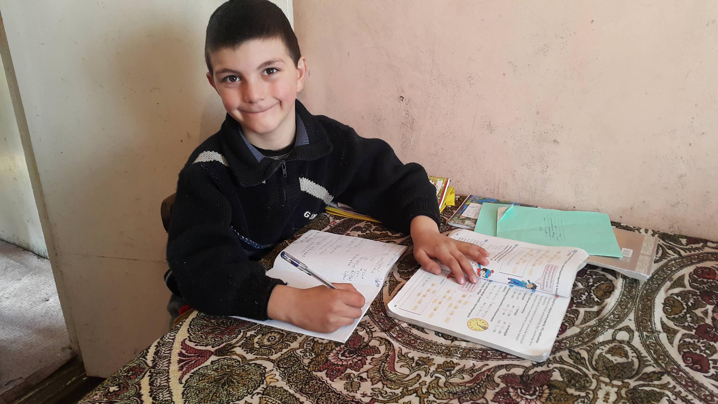 Vrezh doing school work